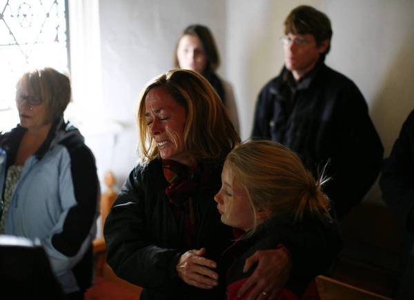 A woman cries during a prayer service at St. John's Episcopal church near Sandy Hook Elementary School.