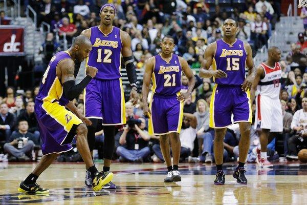 Kobe Bryant celebrates during the closing minutes of the Lakers' 102-96 win over the Washington Wizards at Verizon Center.