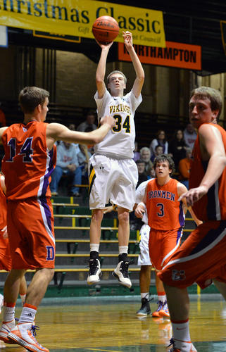 Central Catholic's Michael Kammerer (34) looks for a goal against Danville during a boys basketball game on Saturday.