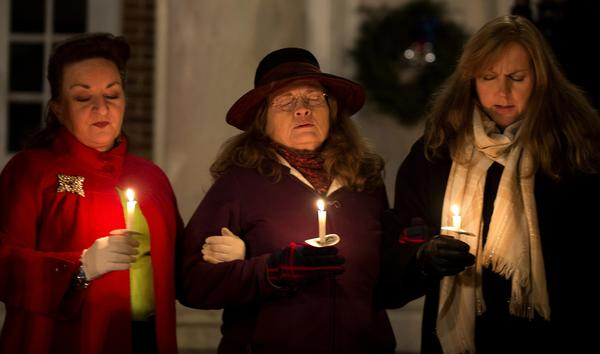 A candlelight vigil is held in Sandy Hook for the victims of Friday's shootings.
