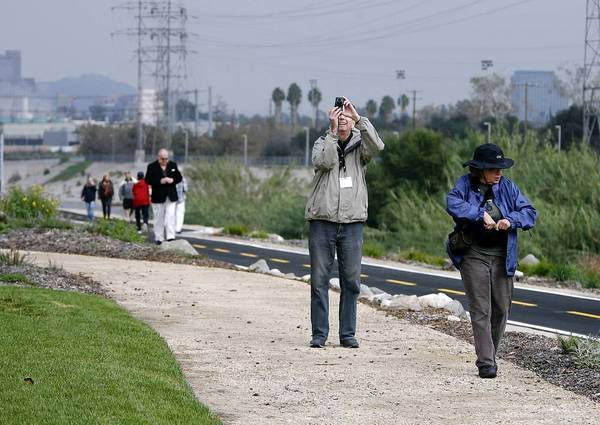 Bob Thompson takes a photo while Jeanne LeFever looks around during the grand opening of Phase 1 of the Glendale Narrows Riverwalk in Glendale on Wednesday.