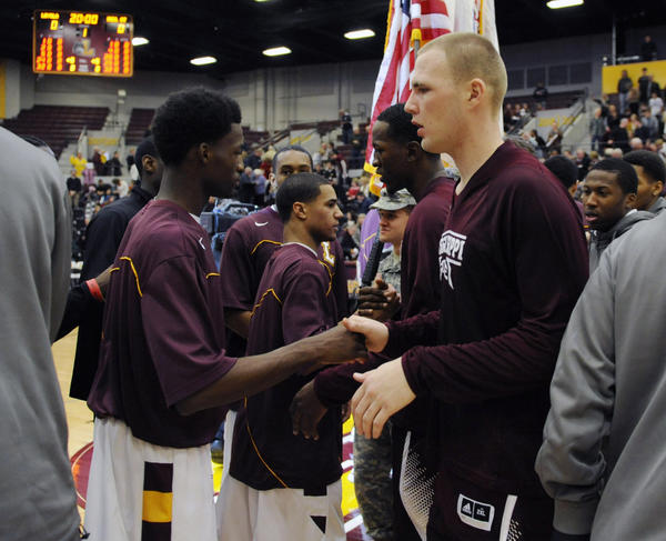 Loyola and Mississippi State Bulldogs players shake hands before the game. It is the first time the teams played since 1963 in a game that helped integrate the country.
