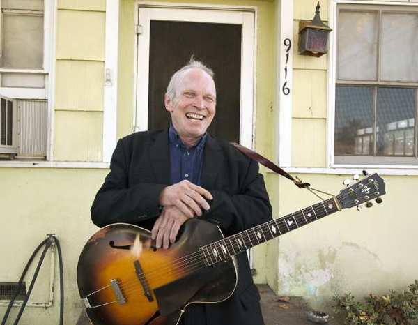 Singer Phil Alvin of the Blasters in front of his boyhood home in Downey. After a health scare earlier this year while on tour in Spain, Alvin is back performing and will appear New Year's Eve with Petunia & the Vipers at Joe's Great American in Burbank.