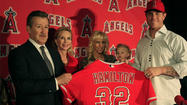 Outside, a red carpet stretched into the happiest restaurant on Earth, filled with giggling little girls and twinkling television trinkets and jolly Josh Hamilton squeezing his giant frame into a cheery red Angels jersey,