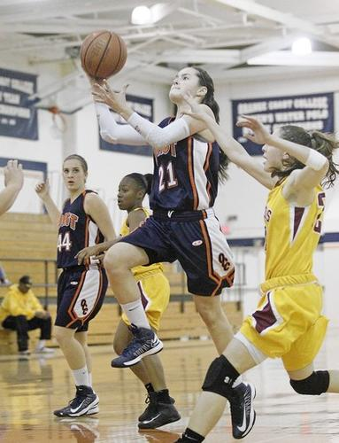OCC's Michelle Angel (21) goes up for a layup during the first half against Saddleback in the Coast Christmas Classic on Saturday.