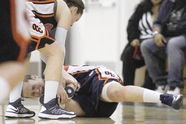 OCC's Caitlin Bunting holds her ankle in pain during the second half against Saddleback in the Coast Christmas Classic on Saturday.