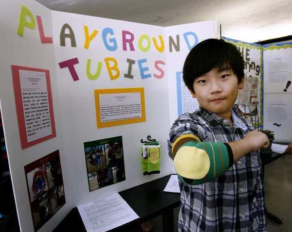 Fremont Elementary School 4th grader Ethan Park shows off his 'Playground Tubies' invention at Glendale Unified School District's 19th annual Invention Convention held at Glendale High School. The tubies keep kids elbows safe in the playground. The convention drew about 122 projects from 4th through 7th grade students.