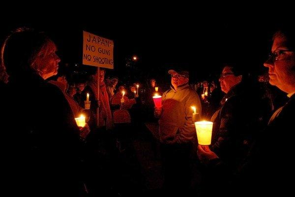 About 60 people came to a candlelight vigil at Glenoaks Park in Glendale on Saturday evening for those killed at Newtown's (Connecticut) Sandy Hook Elementary School.