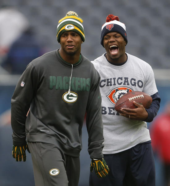 Packers' Charles Woodson and Bears' D.J. Moore have a laugh before the game.