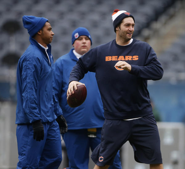 Jay Cutler warms up.