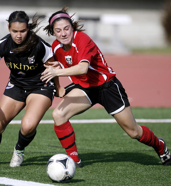 Flintridge Sacred Heart Academy's #9 Laura Thompson, right, battles for the ball with Valencia High School's #9 Carolina Velez, left, during home game at Occidental College in Eagle Rock on Saturday, December 15, 2012.