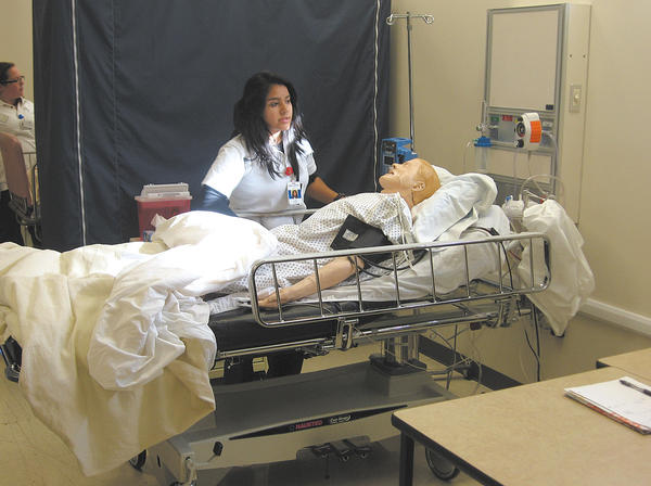 Melissa Hanky, a Towson University nursing student at USMH, participates in a leadership simulation exercise involving a mock multivehicle wreck during a snowstorm.