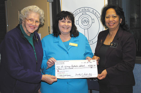 From left, Dorothy Smith, treasurer of the Pangborn Ladies Auxiliary; Patricia McDermott, principal of St. Mary Catholic School; and Julia Navarro, president of the Ladies Auxiliary.