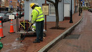 Along the brick streets of Annapolis' historic downtown this week, public works employee Kevin Brown deployed the newest weapon in the city's arsenal.