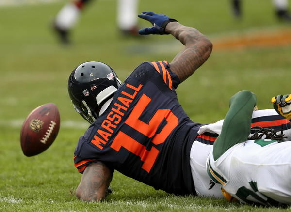 Bears wide receiver Brandon Marshall tries to recover his fumble in the second quarter against Green Bay on Sunday at Soldier Field.