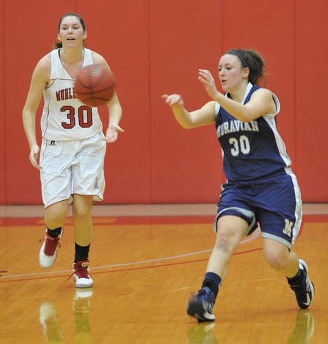 Moravian's Danielle Brogan passes the ball. The Muhlenberg College women's basketball team played against Moravian College Sunday, December 16th, 2012 at Memorial Hall on the campus of Muhlenberg College in Allentown.