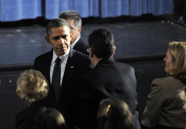 President Barack Obama arrived at Newtown High School at 8 p.m. Sunday and greeted Gov. Dannel P. Malloy before being seated in the audience for the 90 minute service. The president addressed the group toward the end of the vigil.