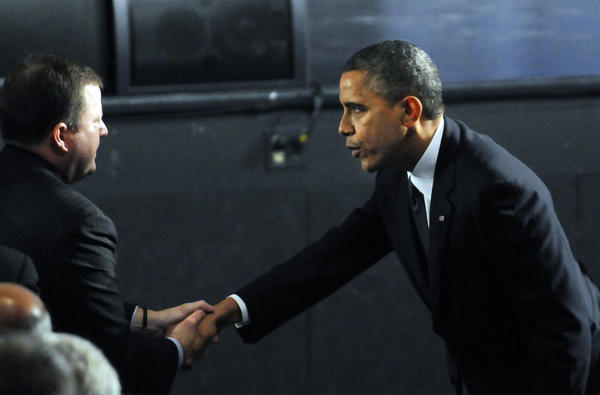 President Barack Obama arrived at Newtown High School at 8 p.m. and greeted John McKinney, R-Fairfield, the Connecticut Senate minority leader, before being seated in the audience for the 90 minute service. The President addressed the group toward the end of the vigil.