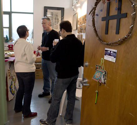 Maryalice Gross, of Bethlehem, and her son Jed Gross, of New Haven, Conn., talk with artist Kevin Haaf, of Lenhardtsville as The Banana Factory holds its 2012 Holiday Open House where resident artists show off their artwork and discuss creative process with visitors to their studios in Bethlehem on Sunday