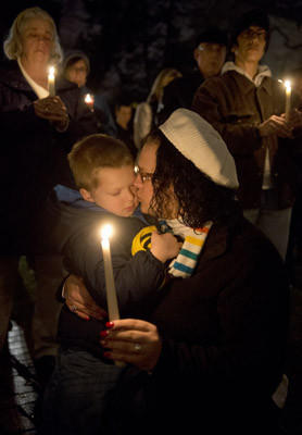 Megan Burk, of Bethlehem, holds her son Shane, age 5, as Central Moravian Church, in Bethlehem, holds an interfaith Candlelight Vigil for Hope to pray for the victims and families of the Newtown School shooting as well as a hope to end violence.