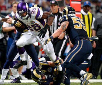 Adrian Peterson slips a tackle against the Rams on Sunday. Peterson rushed for 212 yards in the Minnesota Vikings' win over the St. Louis Rams and, with two games remaining, is 294 yards away from the NFL's single-season rushing record.