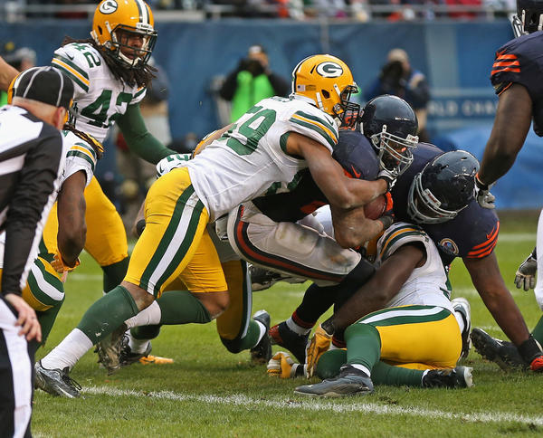 Matt Forte #22 of the Chicago Bears is stopped short of the goal by Brad Jones #59 of the Green Bay Packers at Soldier Field on December 16, 2012 in Chicago, Illinois. The Packers defeated the Bears 21–13.