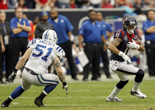 DeVier Posey #11 of the Houston Texans tries to run past Pat Angerer #51 of the Indianapolis Colts in the second half at Reliant Stadium on December 16, 2012 in Houston, Texas. Texans win 29–17 to clinch the AFC South.