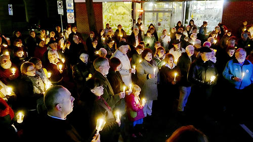 People gather in the Waynesboro Square at a candlelight vigil for victims of mass shooting on Newtown, Conn.