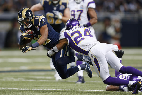 A.J. Jefferson #24 of the Minnesota Vikings tackles Brandon Gibson #11 of the St. Louis Rams during the game at Edward Jones Dome on December 16, 2012 in St. Louis, Missouri. The Vikings won 36–22.