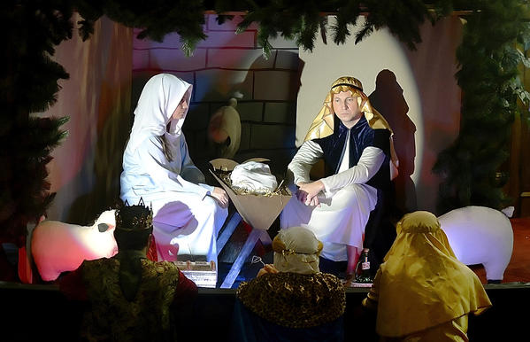 Terra Deatrich and Deron Crawford play Mary and Joseph in a live nativity scene during a Christmas Cantata at Washington Square United Methodist Church.