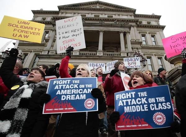 Opponents of right-to-work legislation demonstrate at the Michigan Capitol in Lansing on Dec. 11.