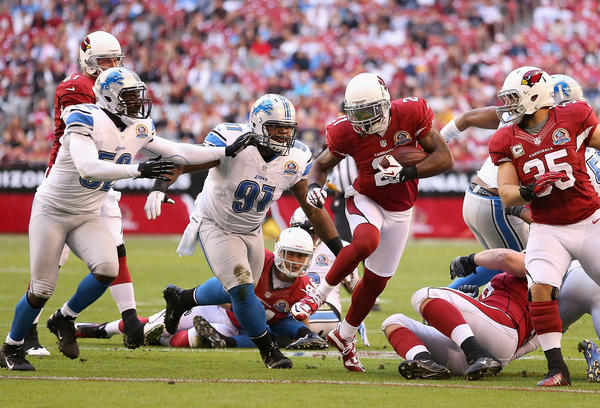 Cornerback Patrick Peterson #21 of the Arizona Cardinals rushes the football against the Detroit Lions during the first quarter of the NFL game at the University of Phoenix Stadium on December 16, 2012 in Glendale, Arizona. The Cardinals defeated the Lions 38–10.