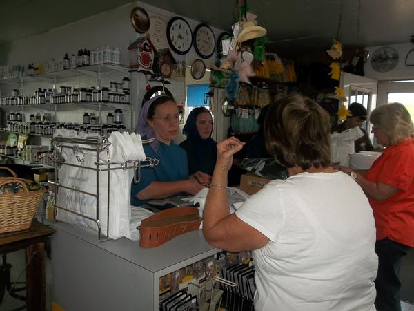 Anna (Brenneman) Fisher (pictured to far left behind counter), grew up in a family business at her father's shop, Mark's Harness Shop, located right next to her childhood home. Now, Anna and her son, Cephas, help on a regular basis at the shop.