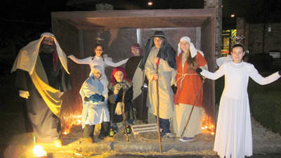 The members of the youth group at Calvary United Methodist Church on Stockholm Avenue in Windber, along with their pastor John Snyder are shown portraying the nativity scene outside the church on Saturday night.