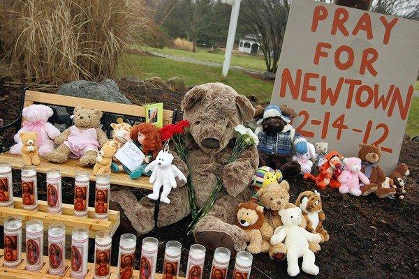Stuffed animals and a plea for prayer are part of a memorial at the Newtown, Conn., police station for victims of the shooting rampage at Sandy Hook Elementary School.