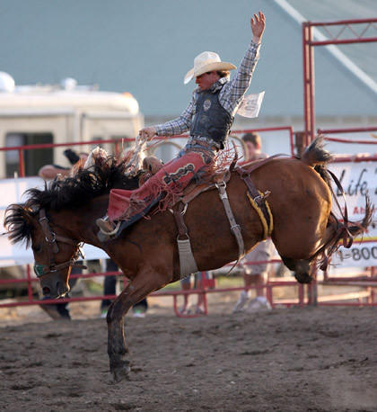 Saddle bronc rider Cole Elshere of Faith rides First Date at the Dacotah Stampede Rodeo this summer in Aberdeen. American News File Photo by John Davis