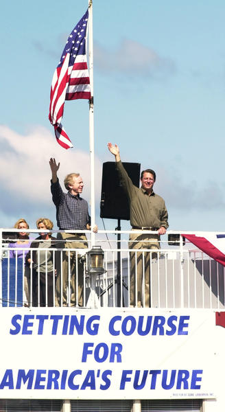 La Crosse 8-18-2000 Vice President Al Gore, and his  running mate Joe Lieberman wave to their supporters  as thery ride aboard the Mark Twain Riverboat after a morning rally in La Crosse, WI. They started  on their first campaign trip after their Convention in LA, by embarking on a boat and bus trip down the Mississippi River.