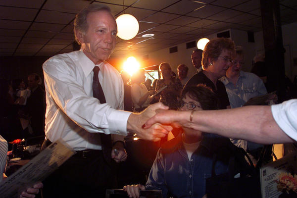 PEORIA, IL; 9.5.00:  Senator Joseph Lieberman shakes hands with a supporter at the Kaffee Haus resturant on his first stop of the campaign day.