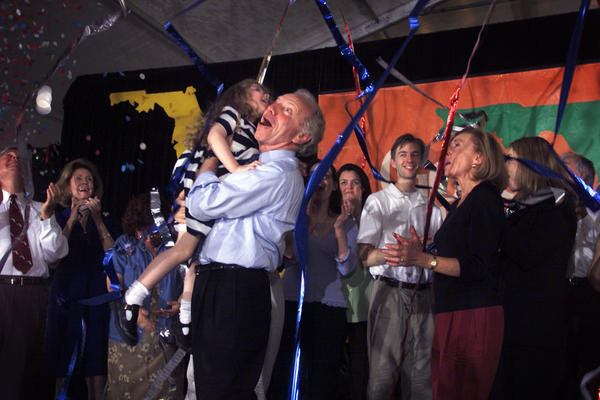 FT. LAUDERDALE, FL: 11.3.2000:   Senator Joseph Lieberman, holding his granddaughter Tennessee, gestures in suprise after confetti and streamers explode over the stage at a get out the vote rally at the Ft. Lauderdale Stadium Grounds. Joining him are his wife Hadassah, right, and other members of his family.