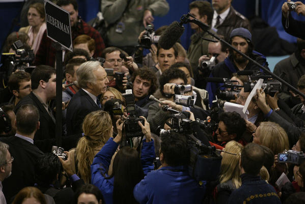 "MANCHESTER, NH; 1/22/04:    Democratic Presidential candidate Senator Joseph Lieberman draws some attention from the media in the ""Spin Room"" after he and other democratic candidates debated at Saint Anselm College."