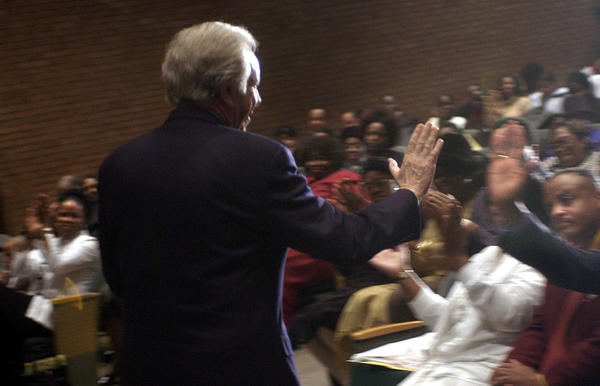 Wilmington, DE 2-1-2004 Sen. Joseph Lieberman held his second campaign stop on this Sunday morning at Remarks at the New Destiny Fellowship Church Service held in the auditorium of Mount Pleasant High School in Wilmington, DE. Here Lieberman high fives, Bishop T.W. Weeks Sr. who led the service after he was introduced by Sen. Tom Carper.