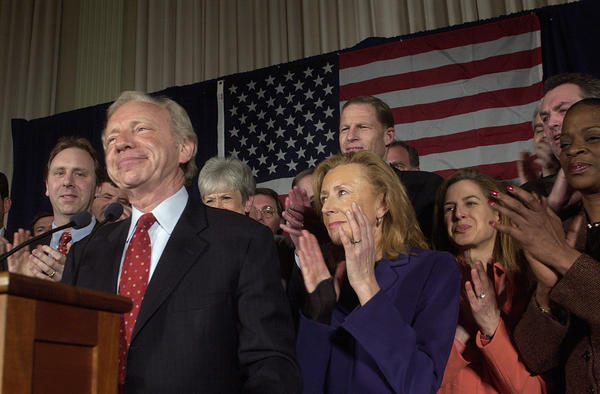 Hartford, CT  2-4-2004 Sen. Joseph Lieberman spoke to friends and supporters in a room on the second floor of Hartford City Hall. In his speech Lieberman thanked the people of Connecticut for their support and apologized for missing a few votes in his quest for the presidency. Here, Senator Lieberman accepts applause from his supporters after his introduction. Behind him from left are, his son, Matt Lieberman, Nancy Wyman, Comptroller partially hidden behind Lieberman, Hadassah, his wife, Richard Blumenthal, Attorney General, Susan Bysiewicz and Denise Nappier, Treasurer.