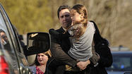 NEWTOWN, Conn. (AP) — A grieving Connecticut town braced itself Monday to bury the first two of the 20 small victims of an elementary school gunman and debated when classes could resume — and where, given the carnage in the building and the children's associations with it.