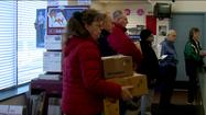 Americans mailing cards and packages coast to coast will hand over more than 658 million pieces of mail Monday to the United States Postal Service. The USPS has already seen a 20 percent surge in business compared to last year.