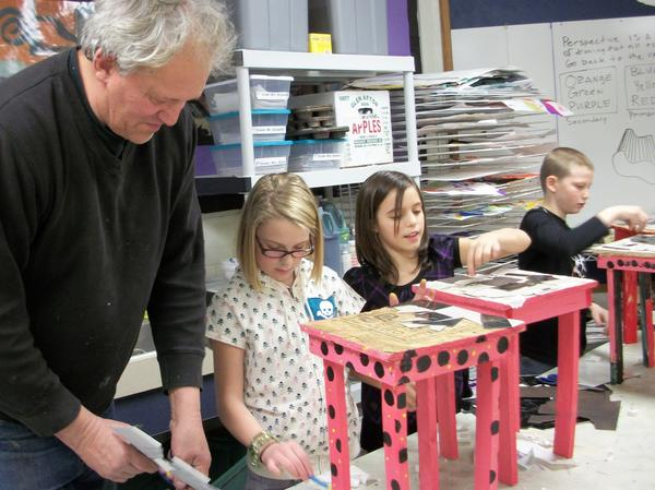 Crooked Tree Arts Center instructor Frank Hasseld (from left) works with East Jordan Elementary School students Madelyn Cochran, Adamarae Moore and Joseph Hosler in an after school arts enrichment class. The students are shown with the tables they built in the class.