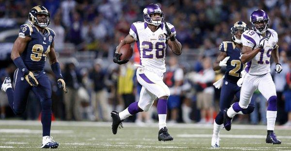 Minnesota Vikings running back Adrian Peterson runs 82 yards for a touchdown Sunday against the St. Louis Rams.
