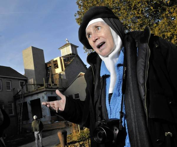 Mother Dolores Hart stands in front of the ongoing renovation of the main monastery building at the Abbey of Regina Laudis in Bethlehem. The convent has been raising funds for the building's renovation, which is now underway.