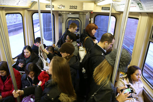 Commuters are crowded on an inbound CTA Brown Line train near the Armitage Station on Monday.