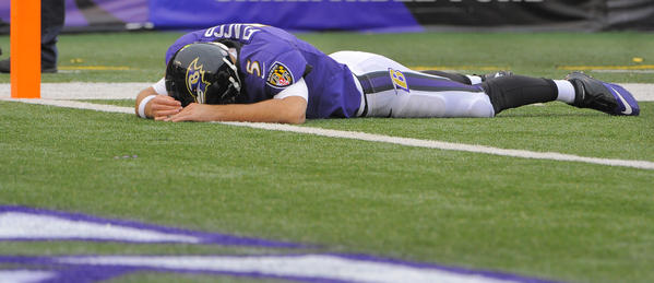 Baltimore Ravens quarterback Joe Flacco (5) lies just short of the goal line, beaten by Denver Broncos cornerback Chris Harris (25), who intercepted his pass intended for wide receiver Anquan Boldin in the second quarter at M&T Stadium in Baltimore, Maryland, Sunday. The Broncos defeated the Ravens, 34-17.