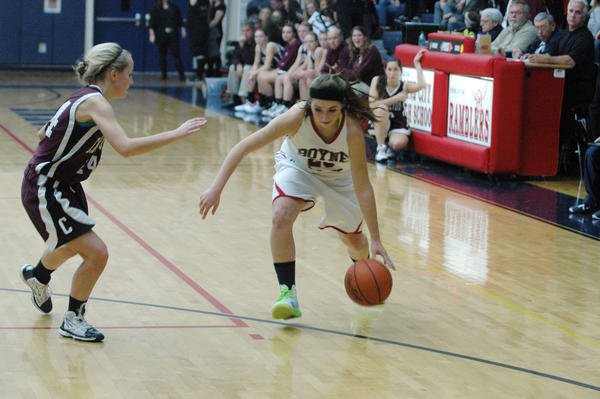 Boyne City junior Rainy McCune (right) starts to drive on Charlevoix sophomore Ellie Way during Friday's Lake Michigan Conference contest at the Boyne City High School gym.